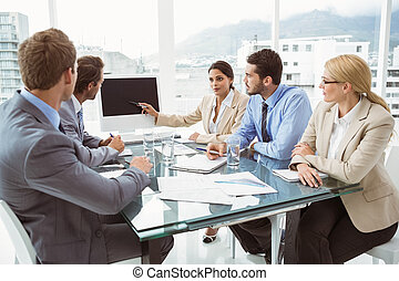 Business people in board room - Young business people in...