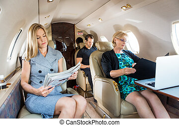 Business People In Corporate Jet