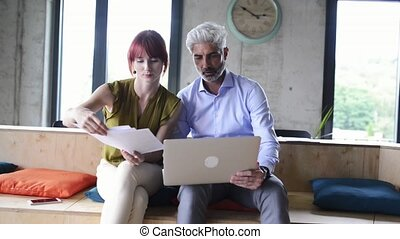 Business people in creative office consulting a project. -...