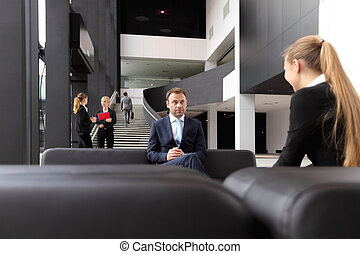 Business people in lobby