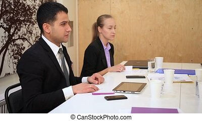 Business people in meeting exchanging business cards