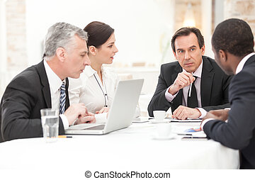 Business People In Meeting - Group Of Coworkers Discussing...