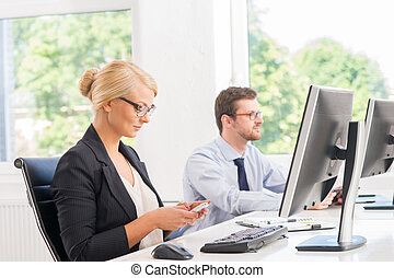 Business people in the office - Attractive female office...