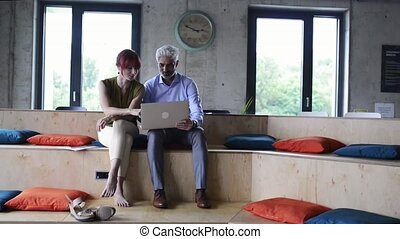 Business people in the office consulting a project. - Two...