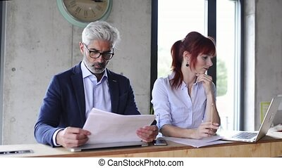 Business people in the office working on a project. - Two...
