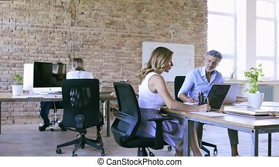 Business people in the office working together.