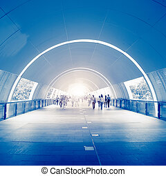 Business People in underpass - fast life in the City with...
