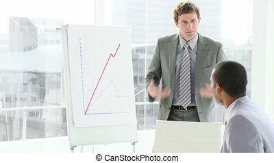 Business people interacting in a me