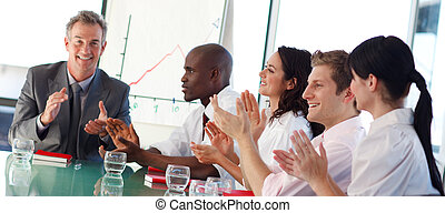 Business people interacting in a meeting - Multi-ethnic...