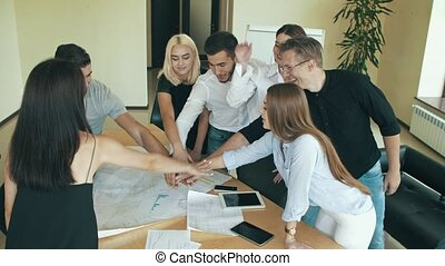 Business people join hand together