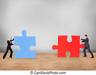 Business People Joining Puzzle Pieces On Desk
