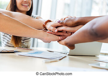 Business people joining their hands together