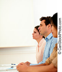 Business people listening during a conference