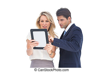 Business people looking at a pc tab - Smiling business...