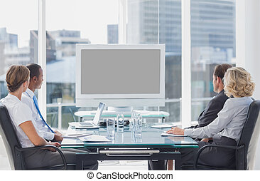 Business people looking at a screen
