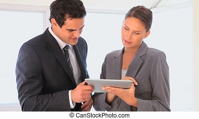 Business people looking at a tablet