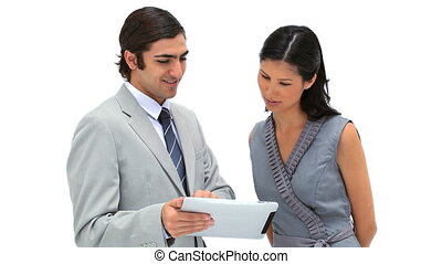 Business people looking at a tablet computer