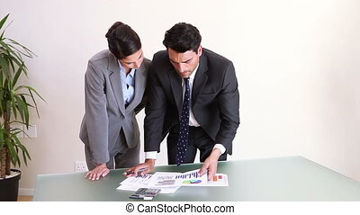 Business people looking at documents