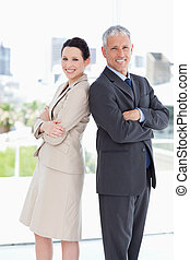 Business people looking at the camera and smiling while standing upright