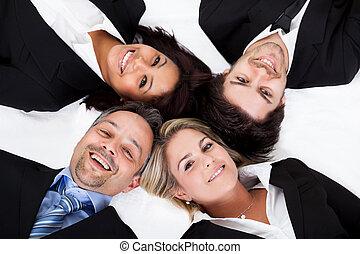 Business people lying head to head