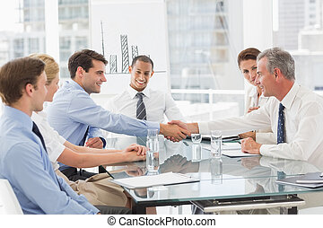 Business people making a deal at a meeting