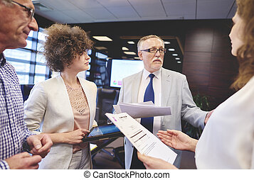 Business people making controversial decision