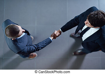 business people making deal - business people shaking hands...