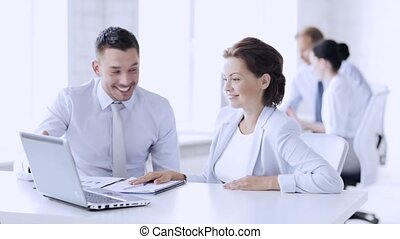 business people in office making high five gesture