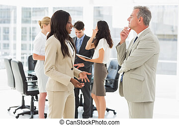 Business people meeting and talking together