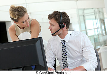Business people meeting in office in front of desktop