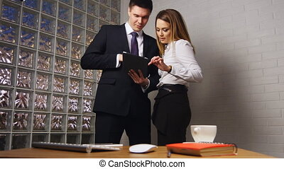 Business people meeting in office with tablet pc