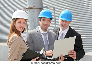 Business people meeting on industrial site