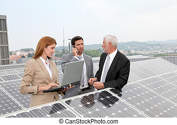 Business people meeting on photovoltaic setup