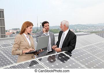 Business people meeting on photovoltaic setup