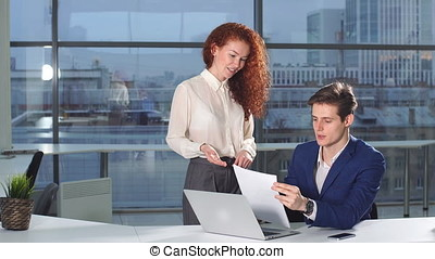 business, people, paperwork and technology concept - busy businessman with laptop computer and papers working in office