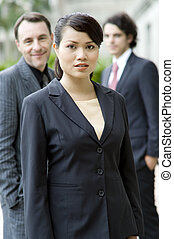 Business People - A young businesswoman standing in front of...