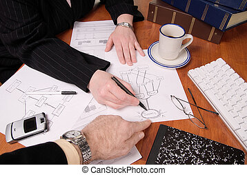 Business people planning - Businessman and businesswoman...