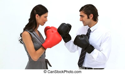 Business people playing with boxing gloves