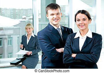 Business people - Portrait of two business people folding...