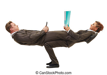 Business people posing in difficult acrobatic pose -...