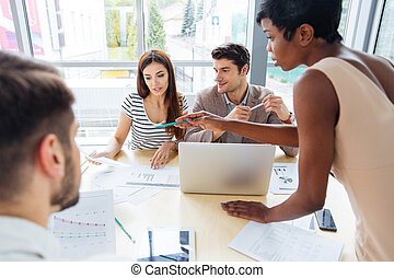 Business people preparing for presentation together in office