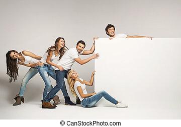 Business people pulling an empty board