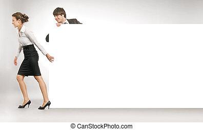 Business people pulling an empty white board, lots of copyspace