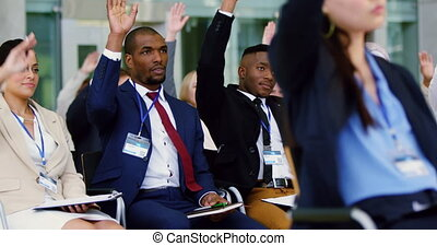 Business people raising their hands in a business seminar 4k