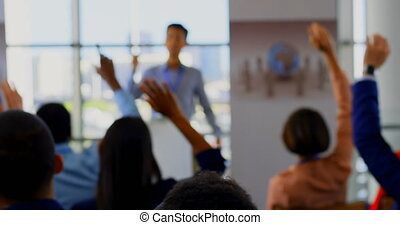 Business people raising their hands in the business seminar 4k
