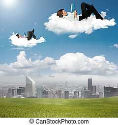 Business people reading book in the sky