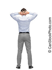 businessman with hands behind his head from back