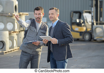 business people reviewing construction plans