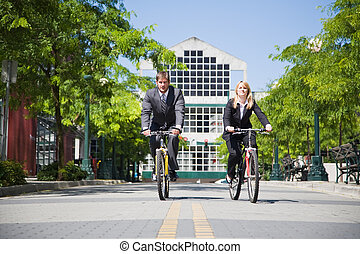 Business people riding bicycle