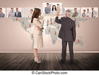 Business people selecting digital interface together